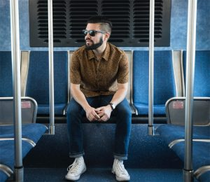 Photo of a man on a bus seat