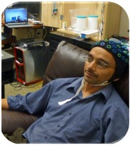 Raj Rao wearing EEG headcap