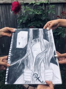 Marginalized Cage, art by Estephanie Guzman, shows a young woman gripping long hair and a key. There is a box with a keyhole in the corner of the picture
