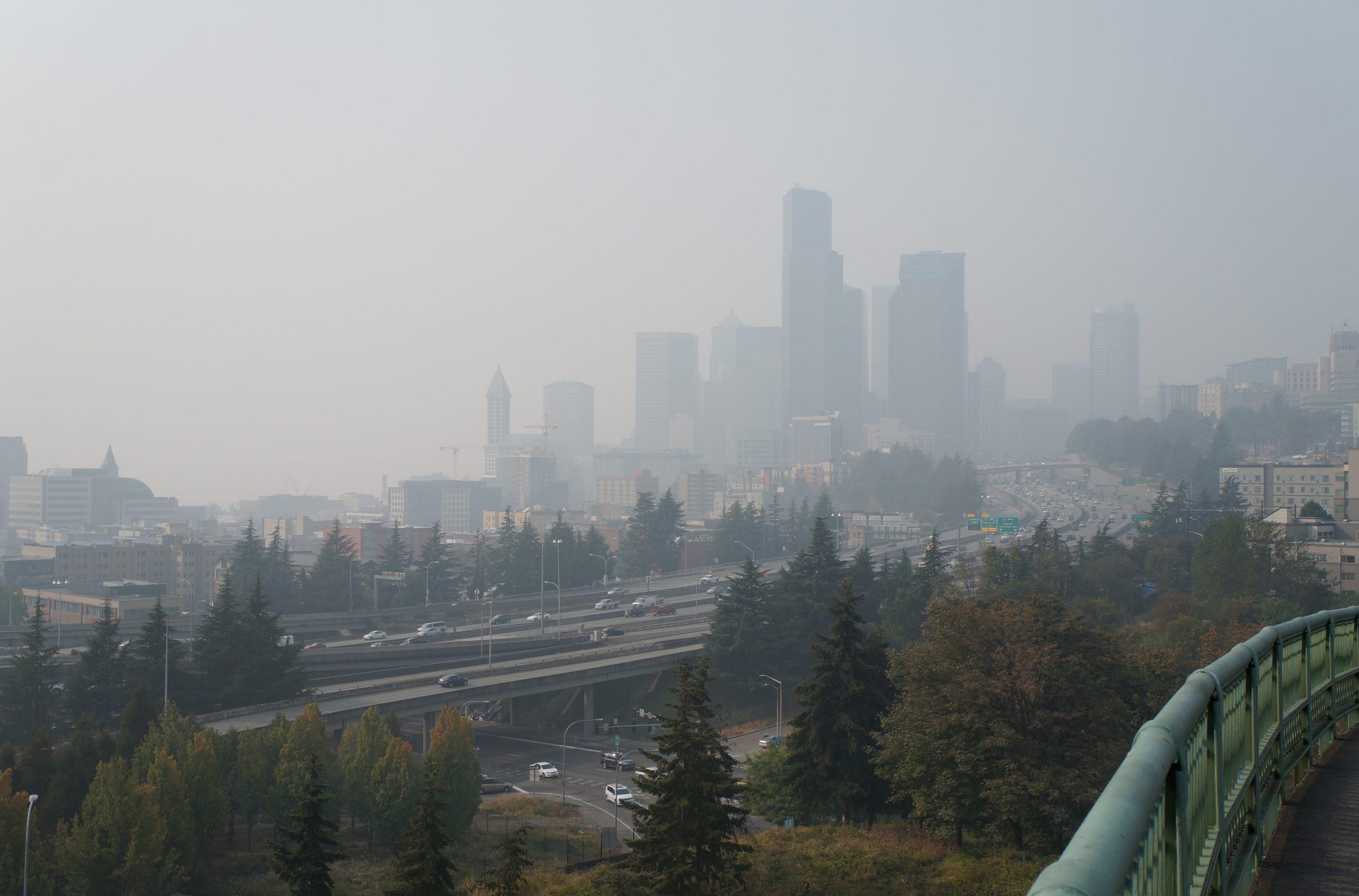 shows a smokey seattle skyline