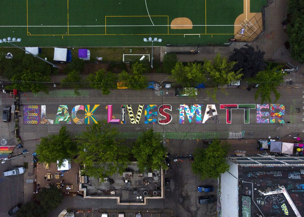 Aerial Photo: The block-long Black Lives Matter street mural, beginning at 10th Avenue and East Pine Street, is shown on Saturday, June 13, 2020, inside the area known as the Capitol Hill Occupied Protest, or CHOP, in Seattle.