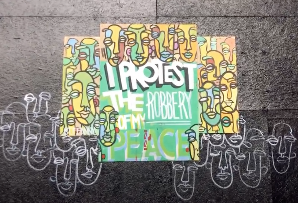 """Protest art on a wall that reads """"I Protest the Robbery of my Peace"""""""