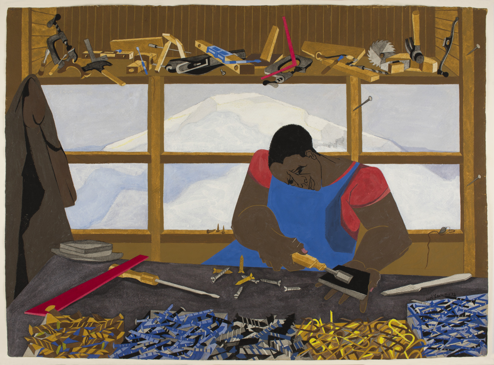 An African American man seated at a work bench, sharpening his carpentry tools, a view of mt. Ranier is present in the windor behind him and he is surround by an array of tools.