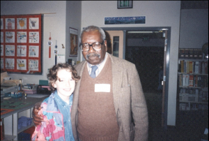 Lawrence with a young student